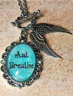 "Just Breathe Glass Pendant---This reminds me of the Ever After movie with Drew Barrymore.  When Cinderella  arrives at the masquerade  ball in her beautiful gown and those big amazing wings and she's so nervous and she says to herself, ""Just breath"" then steps toward her fate.----I would love to have this!"
