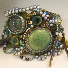 Dripping with her unique style - wrist adornment bead embroidered cuff bracelet by Sherry Serafini.  www.SerafiniBeadedJewelry.com