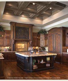 Recessed frig, dark wood cabinetry, medium finish wood floor. Love the tole painted range hood.