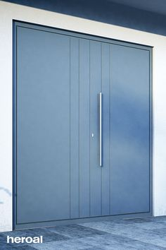 Light grey front door made of durable aluminum with stainless stell handle strip.
