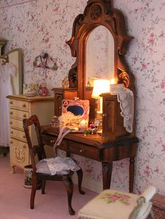 She said:The bedroom is a rose, green and white retreat. I made and hand-painted the armoire and dressing table from kits by Rosemarie Torre.