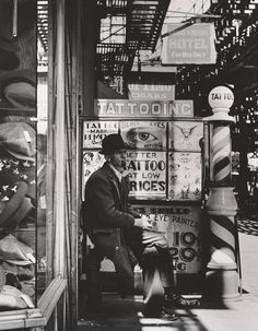 In front of Charlie Wagner's tattooing studio at Chatham Square, 1940. Andreas Feininger 1906 - 1999. Andreas Feininger Archive