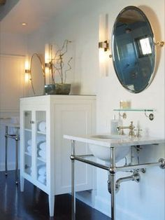 Bathroom sink with countertop space and leg space below for tight spots.