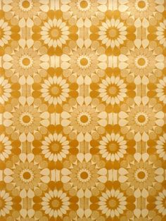Vintage geometric wallpaper with flower pattern in mustard yellow color.