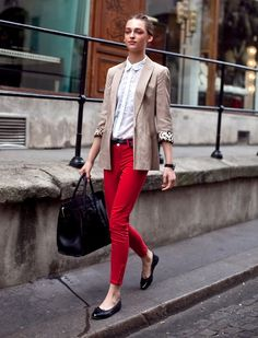 Simple buttoned-up collar, bright red skinny jeans and a blazer with leopard prints under the sleeves.