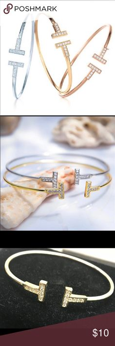 T bangle bracelets $9 each. These beautiful multi colored T bracelets are a perfect Christmas gift! Its unique tshape and rhinestone detailing is what makes it so beautiful! Not only that but very easy on the bank account! Get yours today in Rose & Yellow Gold or Silver. Bundle & save! Offers accepted!! Buy separate or as a set and save as well! Jewelry Bracelets