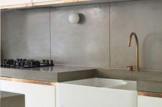 Custom concrete kitchen worktops and splash backs by Haus Concrete Surfaces