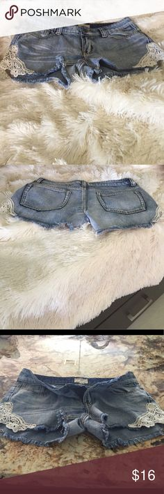 Light Distressed Denim Shorts Adorable, brand new, distressed denim shorts, w/crochet detail on each side. Denim has no stretch, brand is lost, size 27 waist-fit is true to size lost Shorts Skorts