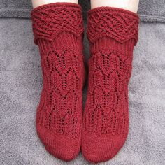 """This is a pattern for a very unique pair of socks. The focal point of the socks is the large and lacy cuff. The sock is constructed in way that's quite uncommon for socks, but allows for the large and """"fancy"""" cuff."""