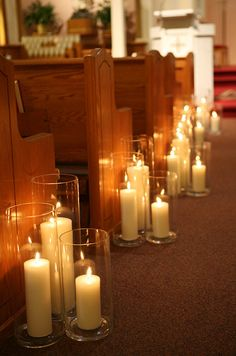 The warm glow of candlelight creates a romantic effect without the use of flowers.