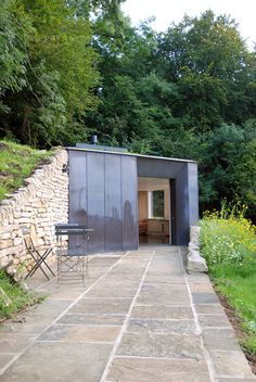 """""""The studio is partially set into the ground in the style of a ha-ha – a traditional landscaping feature consisting of a ditch or excavated wall that acts as a boundary without interrupting views."""" Myrtle Cottage Garden Studio by Stonewood Design"""