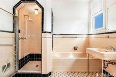 Stunning, 1938 original pail pink and black art deco bathroom. 75 Fairfield Way, San Francisco, CA 94127.