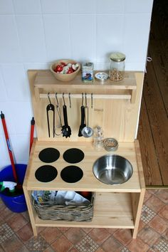 a simple, wooden playkitchen