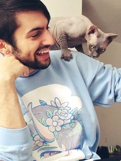Mitch with his and Scott Hoying's cat Wyatt-Blue-Grassi-Hoying