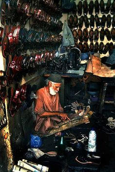 Karachi, Pakistan  - Shoemaker. Nothing more inspiring then people that work hard for their living.