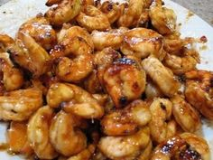 "Sweet and Spicy Honey Grilled Shrimp    2-2 1/2 lb. raw, shelled, de-veined shrimp; raw shrimp are blue or grey, not pink. Get Tiger Shrimp if you can find them. Oh, and that ""vein""? It's not actually a vein. It's poop. Don't let the Euphamism Police trick you.  1 Tbsp. minced or pressed garlic  1/4 c. minced fresh ginger  1/4 c. hot chil"