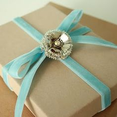 Love the juxtaposition of simple brown paper with luxurious velvet ribbon
