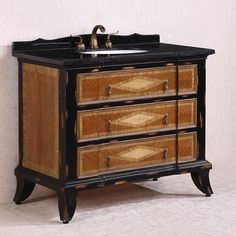 You'll love the one-of-a-kind indented drawer front with drop pendant pull handles that give this single sink vanity a unique appearance. This bathroom vanity is complete with diamond patterned drawers and a contrasting wood appearance.