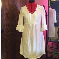 SALE!. Beautiful white dress. Beautiful and pure white,  you can style this dress with any of your accessories.  3/4 sleeves with Ruffles adds that extra feminine touch.  Soft, comfortable material. Polyester/spandex. Machine wash.  Is brand new but does not have tags b c I ordered it online. Ice Silk Dresses