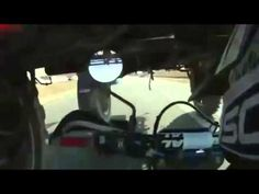 Motorcycle Drives Under Truck