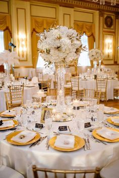 Photographer: Life Studios Inc; Wedding reception centerpiece idea;