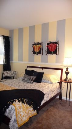 Yellow and grey bedroom with black accents.