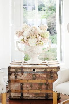 A vintage trunk juxtaposed against florals and soft whites.