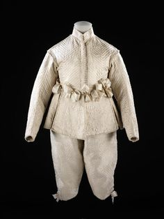 Suit, 1635-1640, England. This quilted doublet and breeches were fashioned from another textile, probably a bed cover. Via Victoria and Albert Museum
