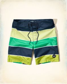 These bold new boardshorts are made to stand out on the beach. Vibrant color, iconic logo, velcro and lace-up closure, Classic Fit, hits at the knee, Imported