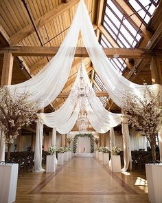 Rustic Glam Wedding in Chicago Epic Rustic Glam Wedding in Chicago. draping fabric for barn, rafters & ceiling.Epic Rustic Glam Wedding in Chicago. draping fabric for barn, rafters & ceiling. Barn Wedding Decorations, Wedding Centerpieces, Wedding Table, Rustic Wedding, Trendy Wedding, Wedding Ideas, Wedding Inspiration, Wedding Alter Decorations, Wedding Cakes