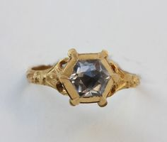 "A large high carat gold ring with a large rose cut rock crystal in hexagonal diamond shaped setting with black enamel decoration on the ""collet"" of the diamond. This set crystal is set again in the most extraordinary way; with a claw setting shaped as bird claws. Maybe it belonged to a Falconer, Europe, possibly Netherlands, dating circa 1580-1620"
