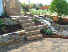 Gorgeous stairway from the deck to a bricked patio. The Vande Hey Company, Inc.