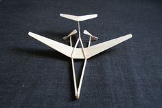 flying three dimensional hand made mostly wooden technically deliberate gone forever Paper Aircraft, Paper Art, Paper Crafts, Airplane Crafts, Wooden Plane, Cheap Toys, Tech Hacks, Homemade Toys, Paper Plane