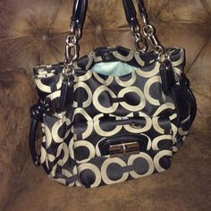Limited edition COACH purse Limited edition coach tote!! Tiny bit of wear around edges on top. Minor staining on inside. Other than that it still looks fabulous! Coach Bags Totes