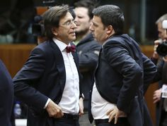 Belgium's Prime Minister Elio Di Rupo talks to his Italian counterpart Matteo Renzi during a European Union leaders summit in Brussels March 20, 2014. REUTERS/Francois Lenoir