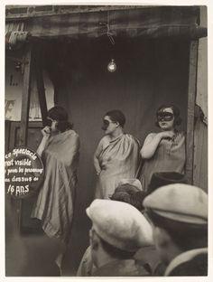 Street Fair, Boulevard St. Jacques, Paris ,1931 by Brassaï
