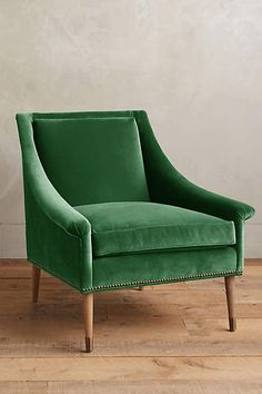 green velvet chair. The perfect place to sip a cocktail before heading out on the town.
