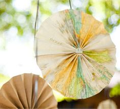 Hanging paper medallions made from maps and natural colors. LOVE.