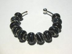 SOLD!!  20 Black & White Ribbon Euro Beads. Starting at $5 on Tophatter.com!  http://tophatter.com/auctions/28088?type=partner