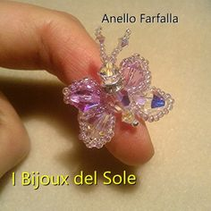 Ring Sun Butterfly with Swarovski crystals and Miyuki beads. Design, planning and carrying out by I Bijoux del Sole. Laura Solerte Copyright 2013. Prezzo base 25 euro
