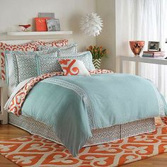 The eye catching Jill Rosenwald® Newport Gate Duvet Cover brings a mix of whimsical designs and vibrant hues to your bed. The slate blue bedding features white embroidered panels, blue swirled prints, and a touch of orange for a lively look.