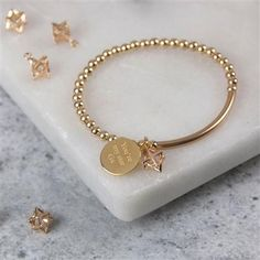 yellow gold filled stretch bracelet with yellow gold plated star pendant featuring a diamond shaped clear glass bead which fits loosely inside and a personalised circular pendant. Cute Jewelry, Gold Jewelry, Jewelry Bracelets, Jewelry Accessories, Jewelry Design, Women Jewelry, Jewelry Crafts, Vintage Jewelry, Star Pendant