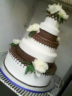 Fondant covered wedding cake with chocolate fondant accents and fresh peonies