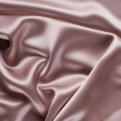 A fine quality stretch silk charmeuse made especially for Mood. Medium-weight, with exquisite drape and a lovely sheen. Lycra adds some crosswise stretch. Silk charmeuse is the fabric of classic gowns, dresses, blouses and lingerie, and it makes a superio Silk Bed Sheets, Silk Bedding, Silk Satin Fabric, Silk Wool, Mood Fabrics, Textile Fabrics, Gold Silk, Pink Silk, Pink Satin