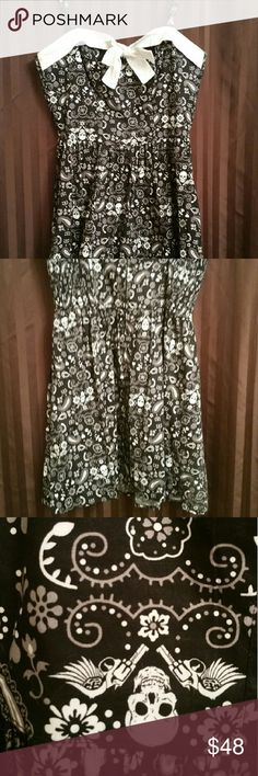 Hell bunny skull paisley pin up rockabilly dress This dress has only been worn once. And it's in great condition with no fading rips stains or tears noted. It's extra large made by Hell Bunny and purchase and a pin up bootique hell bunny  Dresses Mini