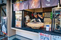 The friendliest dango seller at Narita Temple.