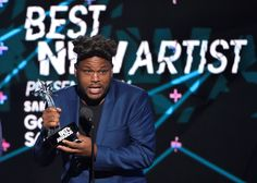 Anthony Anderson accepts the award for best new artist on behalf of Sam Smith at the BET Awards at t... - The Associated Press