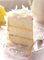 Coconut Cloud Cake  Coconut -- whether fresh-shaved or flaked -- is the star of this elegant cake. Its distinct flavor is exotic yet familiar. Flaked coconut has added sugar and lends extra sweetness, while fresh coconut meat offers a subtle nutty flavor
