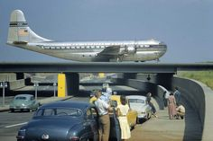 historicaltimes: Sightseers park to watch a Stratocruiser taxi across an underpass in Queens, New York, March 1951 - Read More