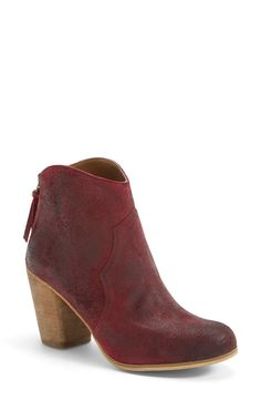 Love the Western appeal of these distressed burgundy leather booties.